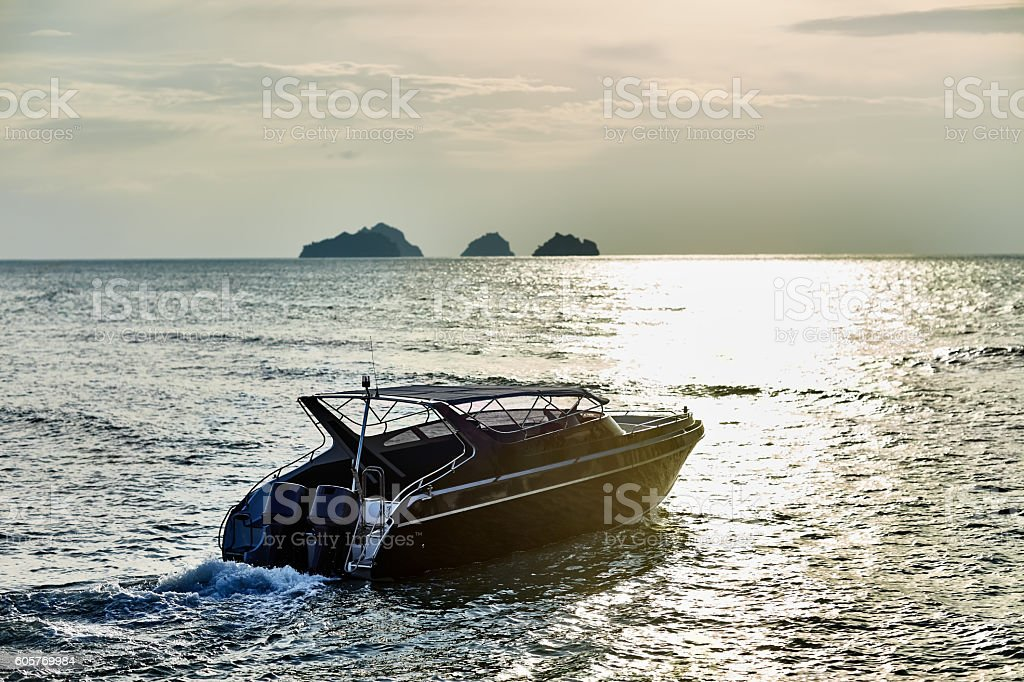 Boat on sunset in the sea stock photo
