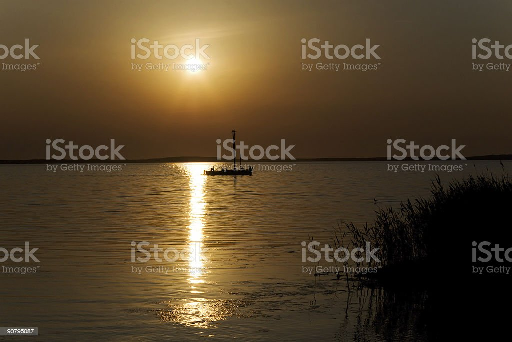 boat on sunset stock photo