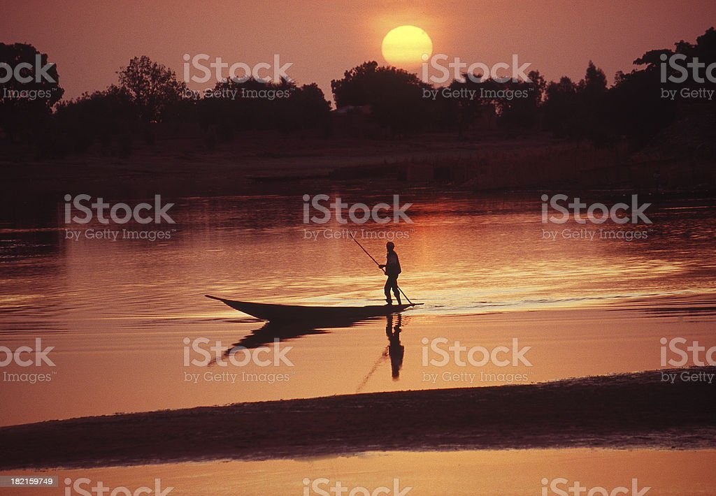 Boat on the Bani river in Mali during sunrise stock photo
