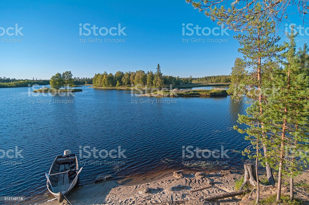 Boat on the bank of the river. stock photo