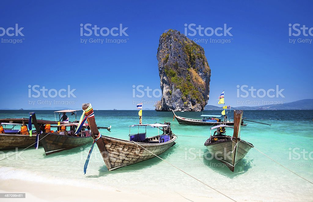 Boat on the beach at Phuket Island, Tourist attraction, Thailand. stock photo