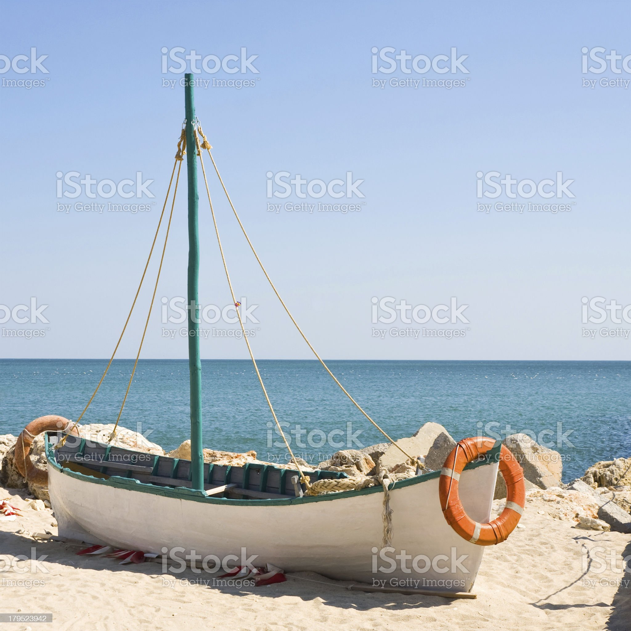 Boat on the beach at sunrise time royalty-free stock photo
