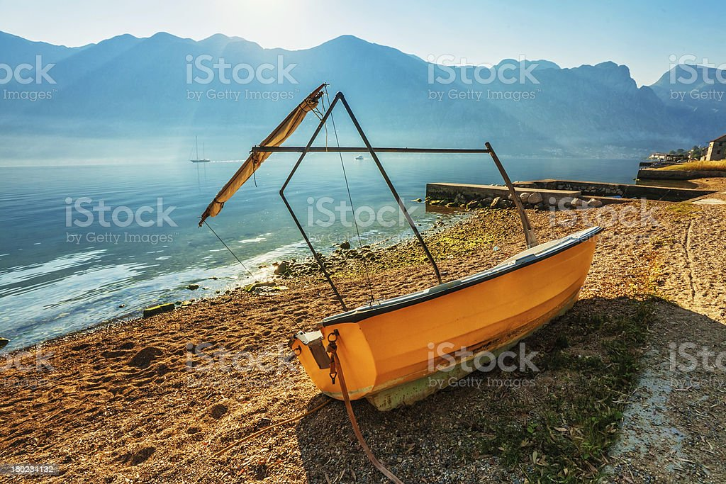boat on the beach early in  morning royalty-free stock photo
