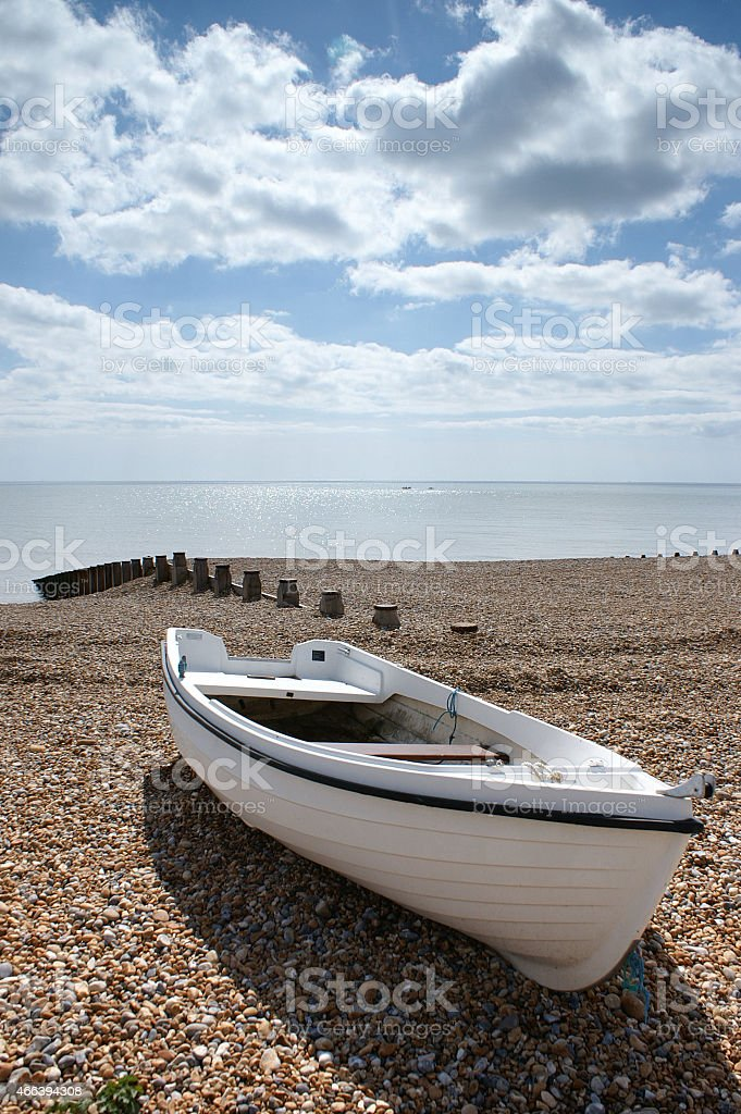 Boat on the beach, south coast of England stock photo