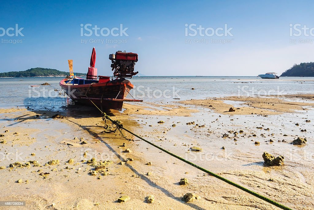 Boat on the beach with blue sky background stock photo