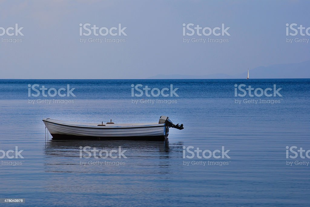 boat on the   blue water stock photo