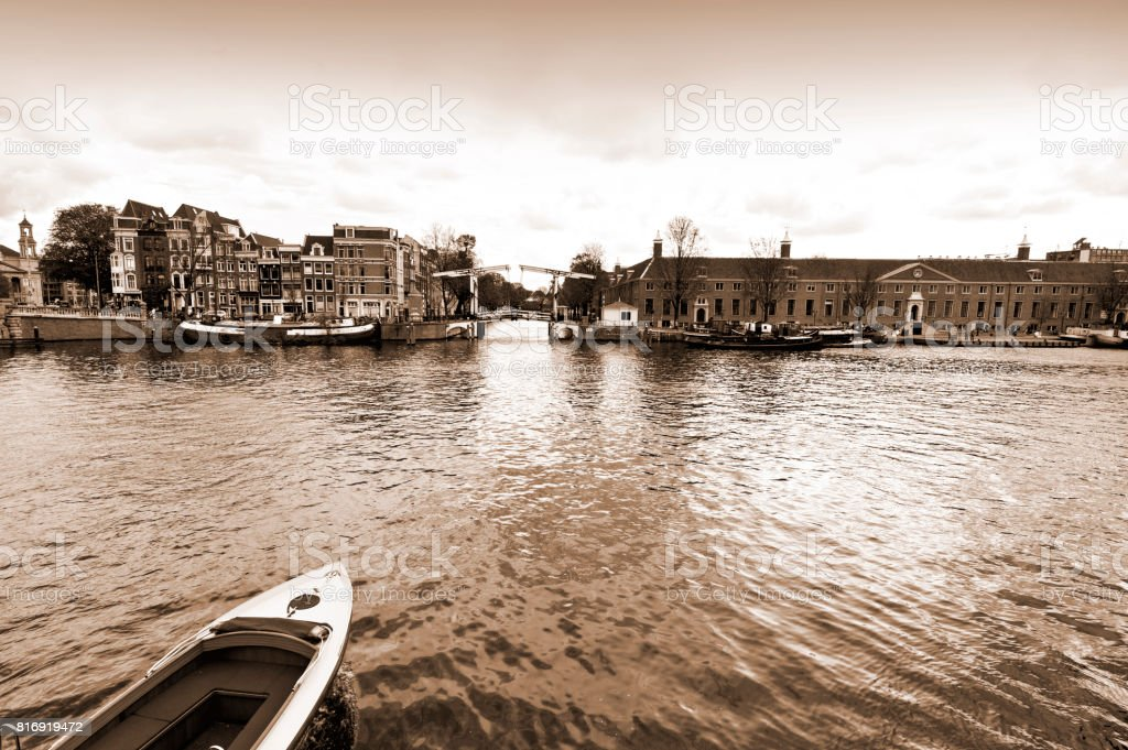 Boat on the Canal of Amsterdam stock photo