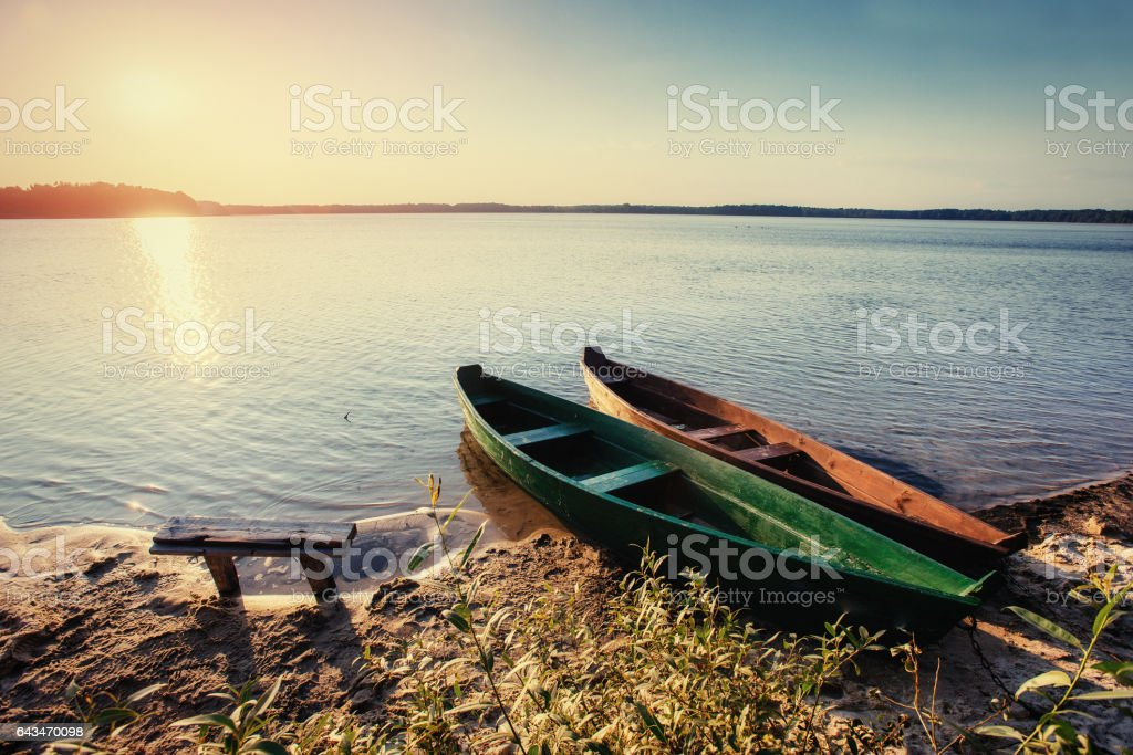 boat on the lake at sunset stock photo