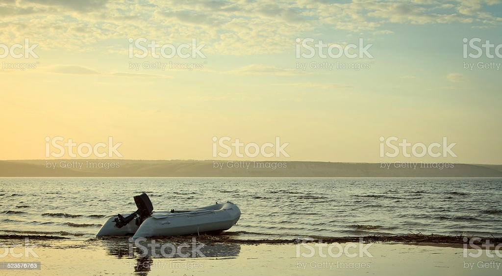 boat on the river in sunset time stock photo