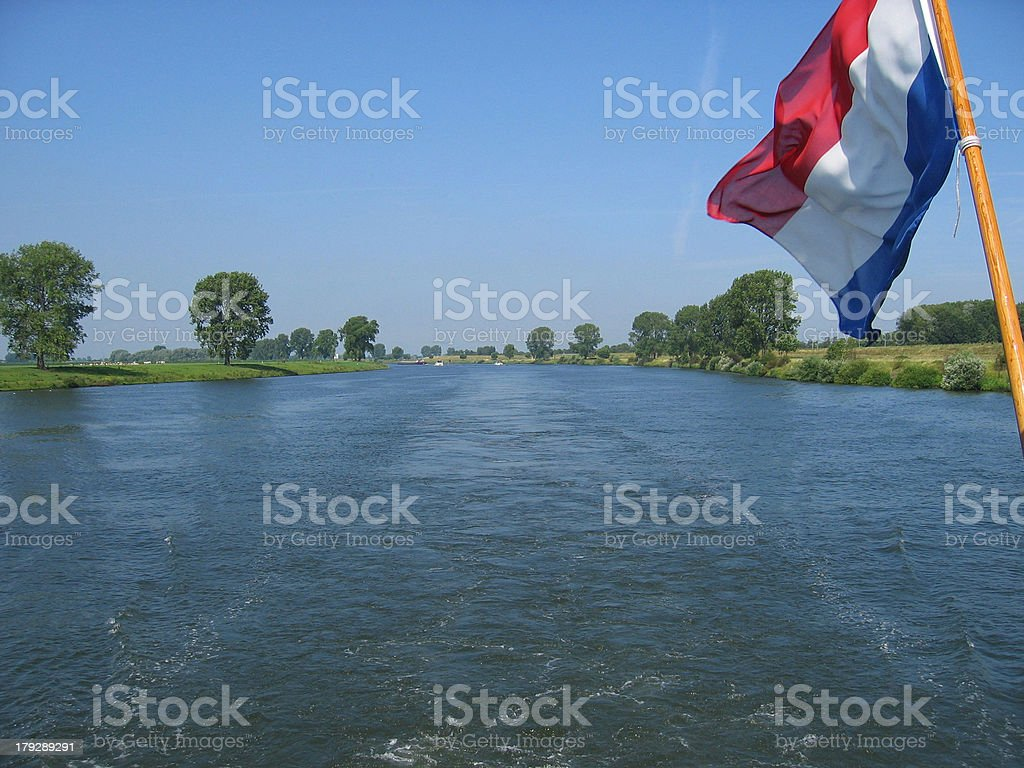 boat on the river with dutch flag stock photo