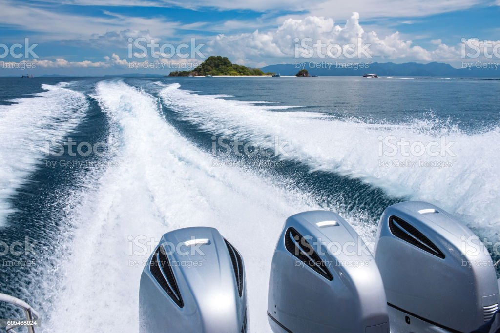 Boat on the sea to fast moving at krabi thailand stock photo