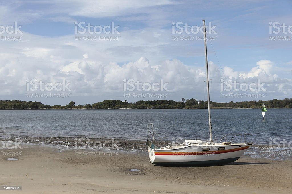Boat on the shore of a bay royalty-free stock photo