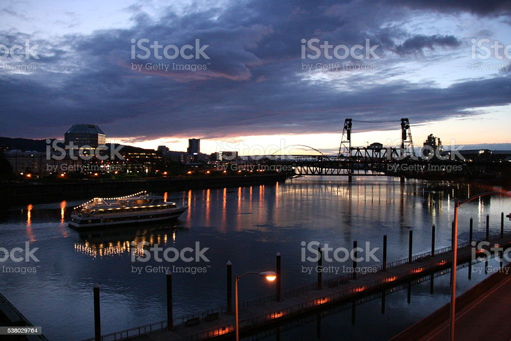 Boat on the Willamette River at Dusk stock photo