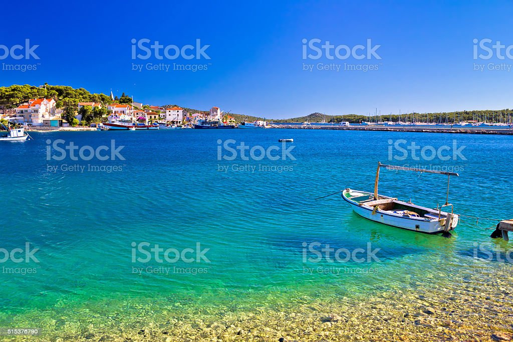 Boat on Turquoise beach in Rogoznica stock photo
