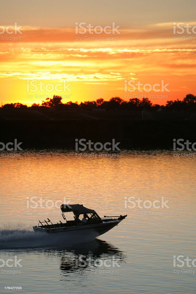 Boat on Water at Sunset stock photo