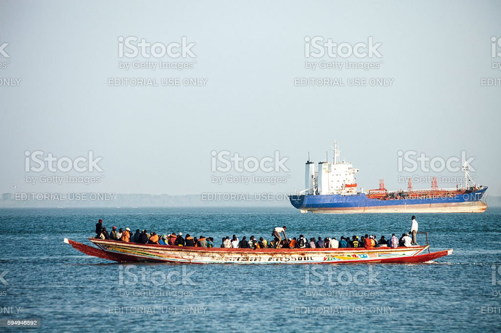 Boat overloaded with people. The Gambia. stock photo