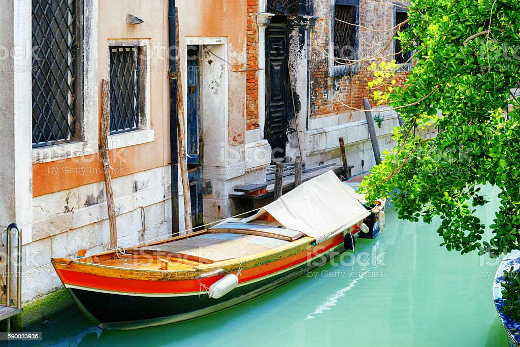 Boat parked beside old housel, Venice stock photo