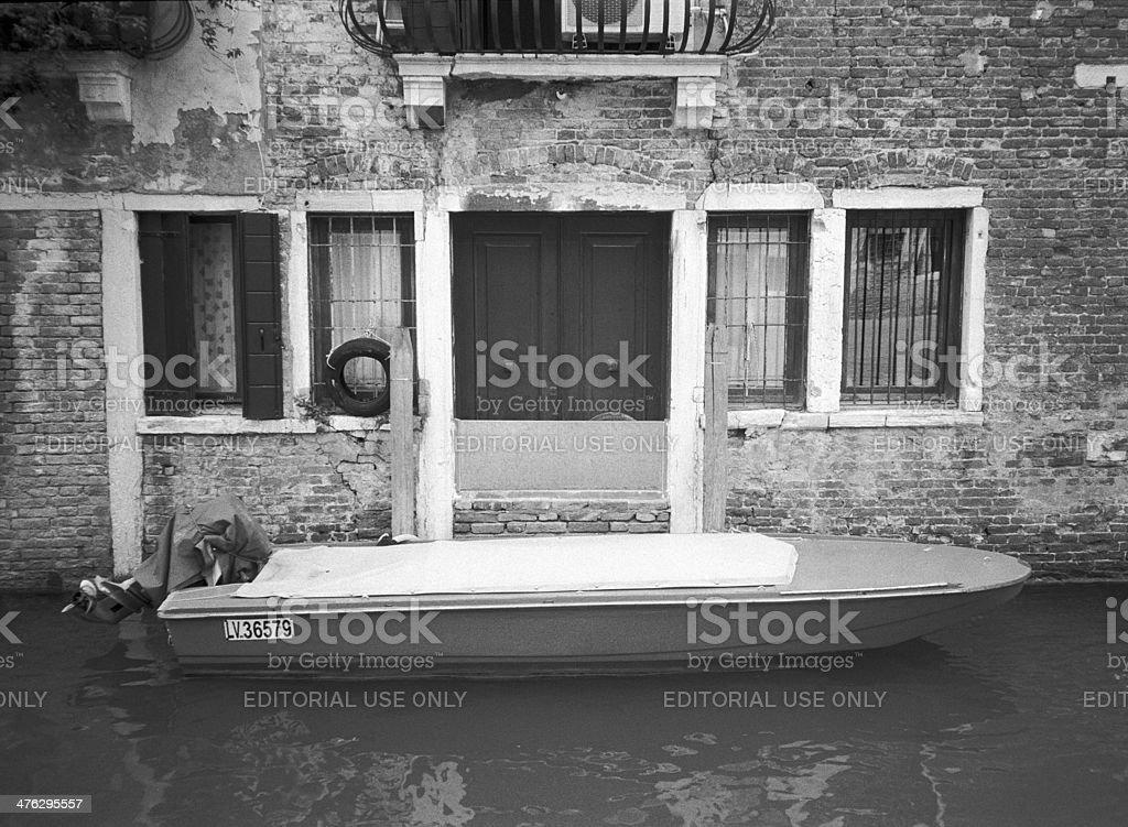 Boat parked near house entrance, Venice royalty-free stock photo