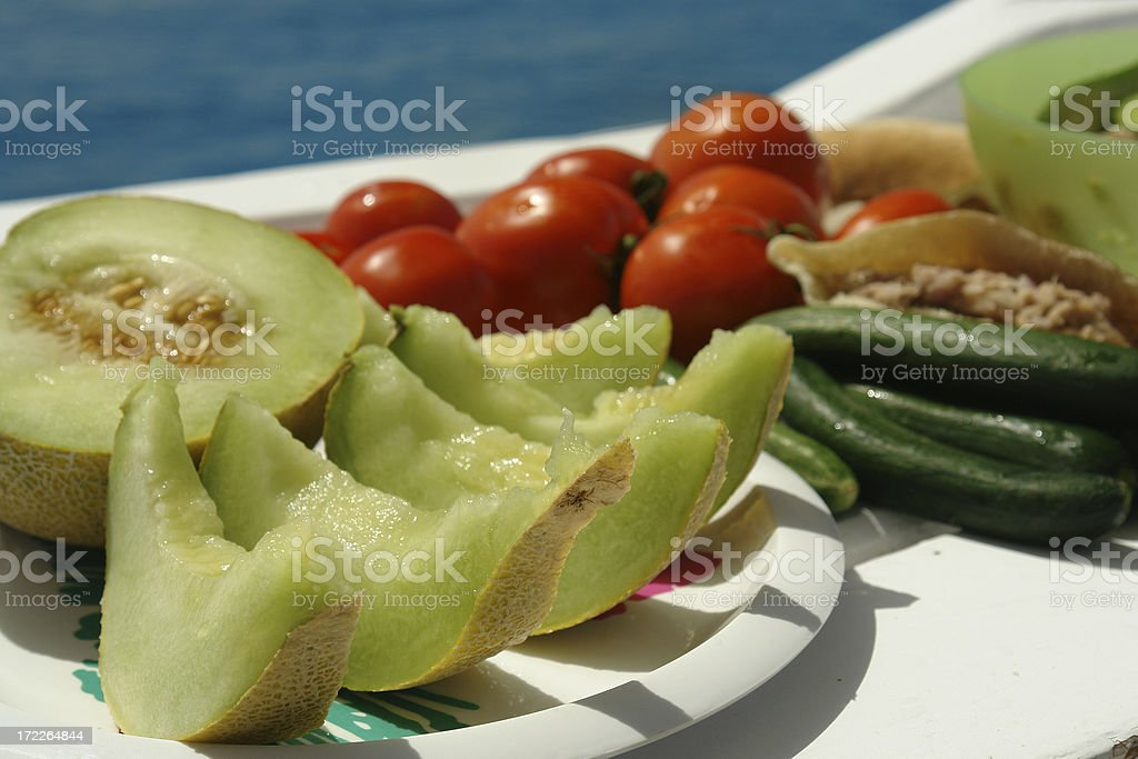 Boat Picnic: Fresh Fruit, Salad and Vegetables royalty-free stock photo