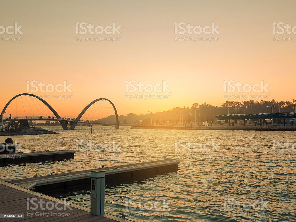 Boat pier for tourists at Elizabeth Quay at sunset. stock photo