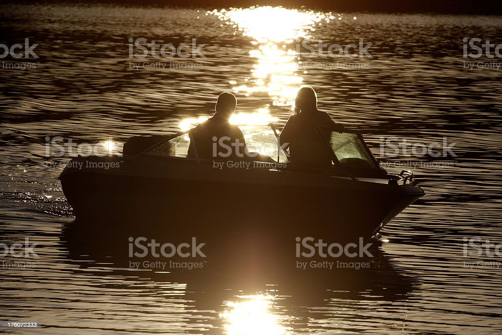 Boat ride at sunset royalty-free stock photo