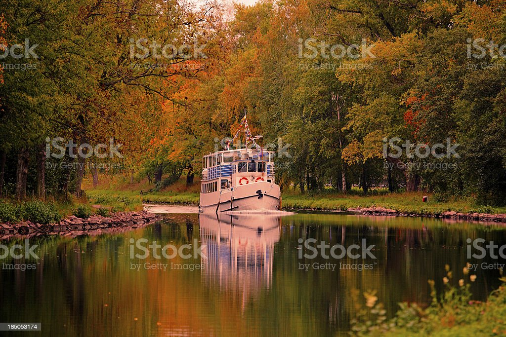 Boat ride into the fall royalty-free stock photo