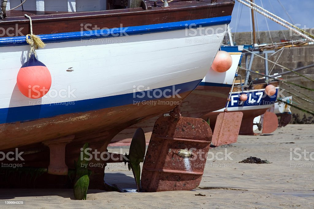 Boat Rudders at Low Tide royalty-free stock photo