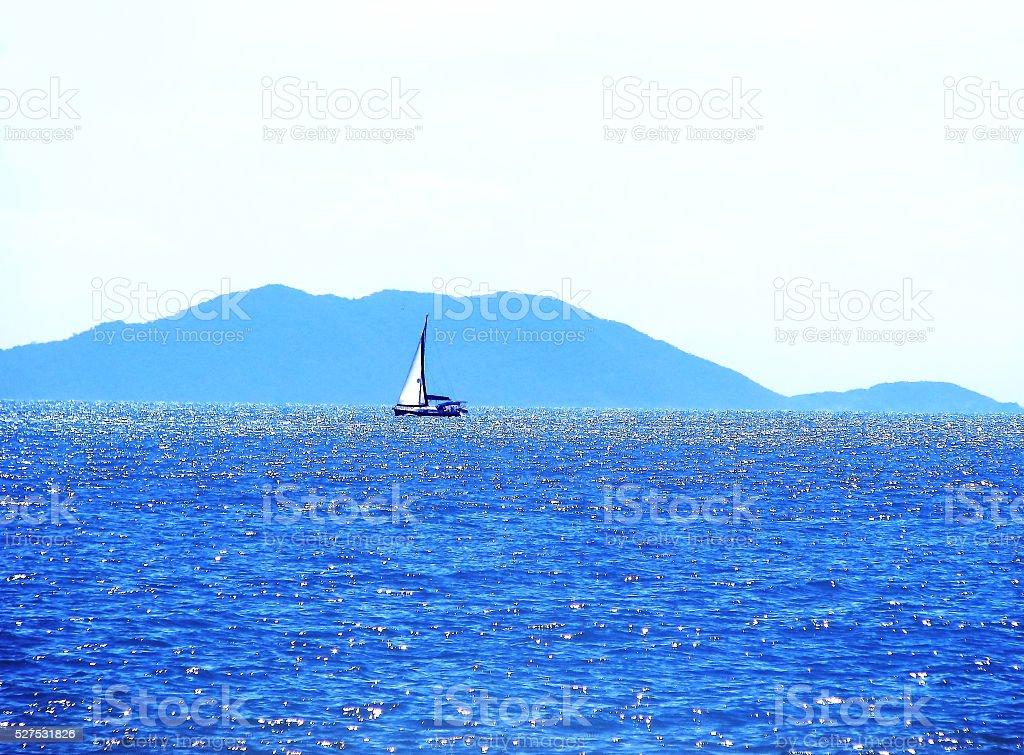 Boat sailing at blue. stock photo