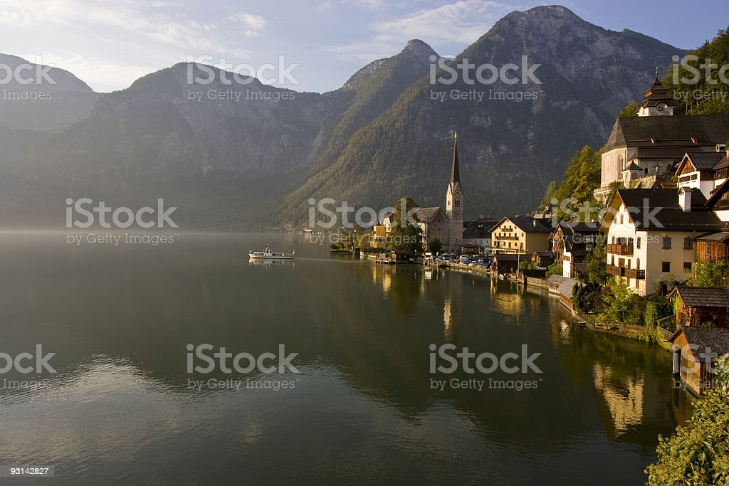 Boat sailing into the morning fog in Hallstatt, Austria royalty-free stock photo