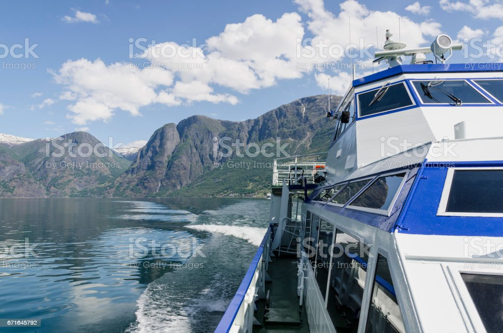 Boat sailing naeroyfjord stock photo