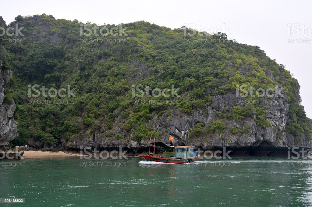 Boat sailing on Lan Ha bay, Vietnam stock photo