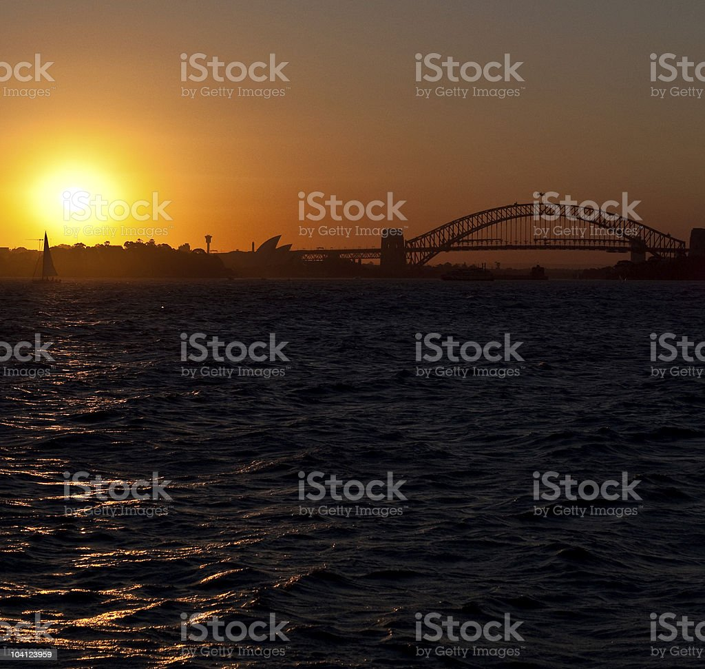 Boat sails past Sydney Harbour at sunset royalty-free stock photo