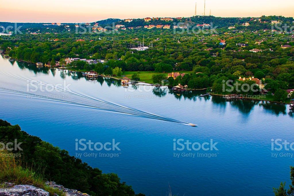 boat showing motion mount bonnell sunrise colorado river stock photo