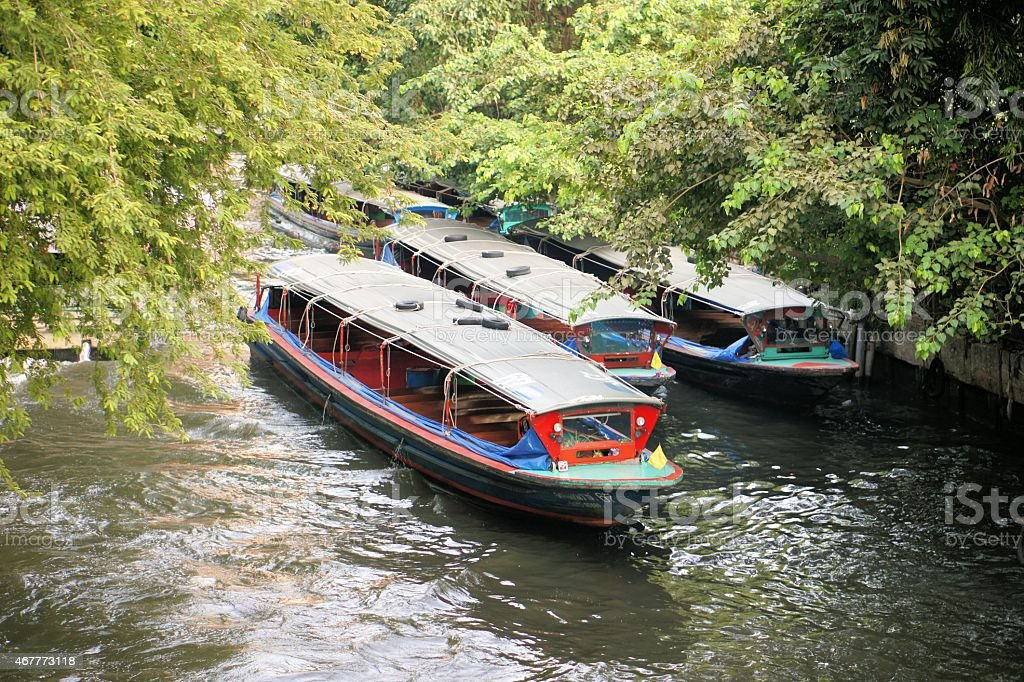 Boat speeding on San Saep canal in Bangkok, Thailand stock photo