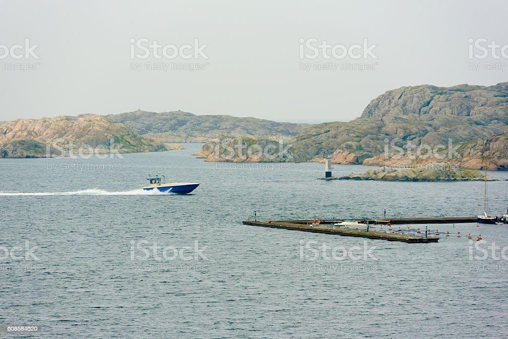 Boat speeding to marina stock photo