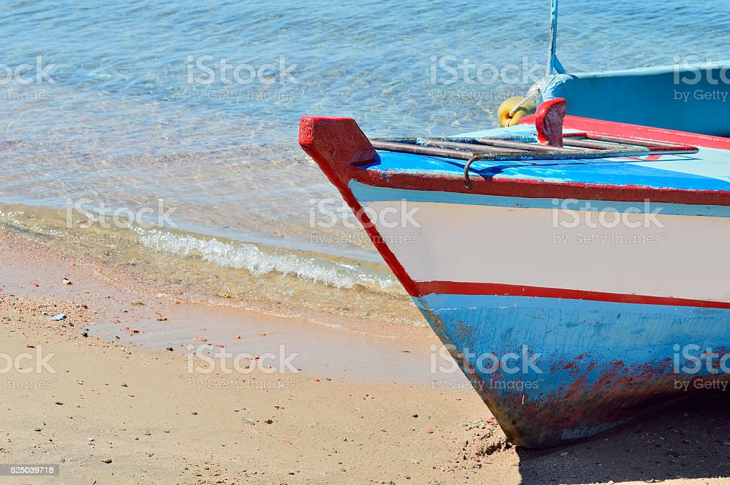 boat stranded on the shore stock photo