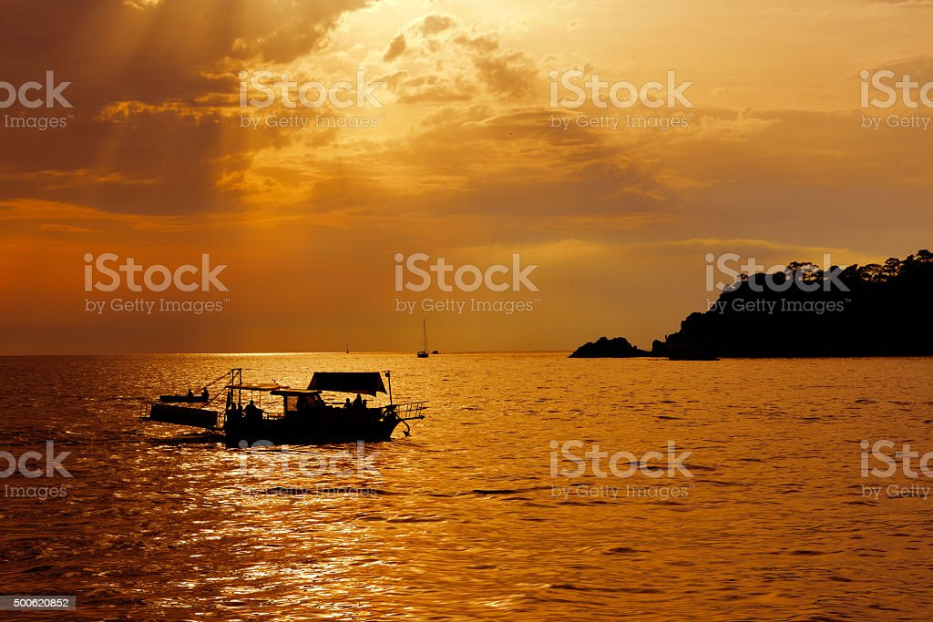 boat tour at sunset stock photo