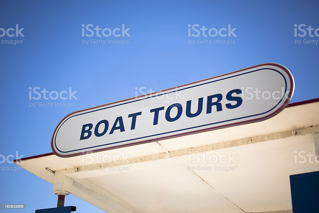 Boat Tours Sign on a Signtseeing Tourboat Stand stock photo
