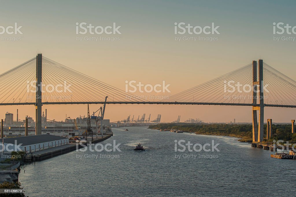 Boat traffic at dusk on Savannah River stock photo