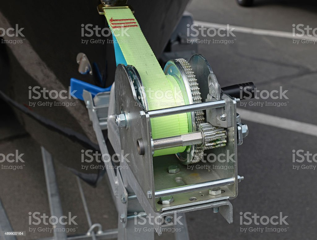 Boat trailer winch with blue rope stock photo