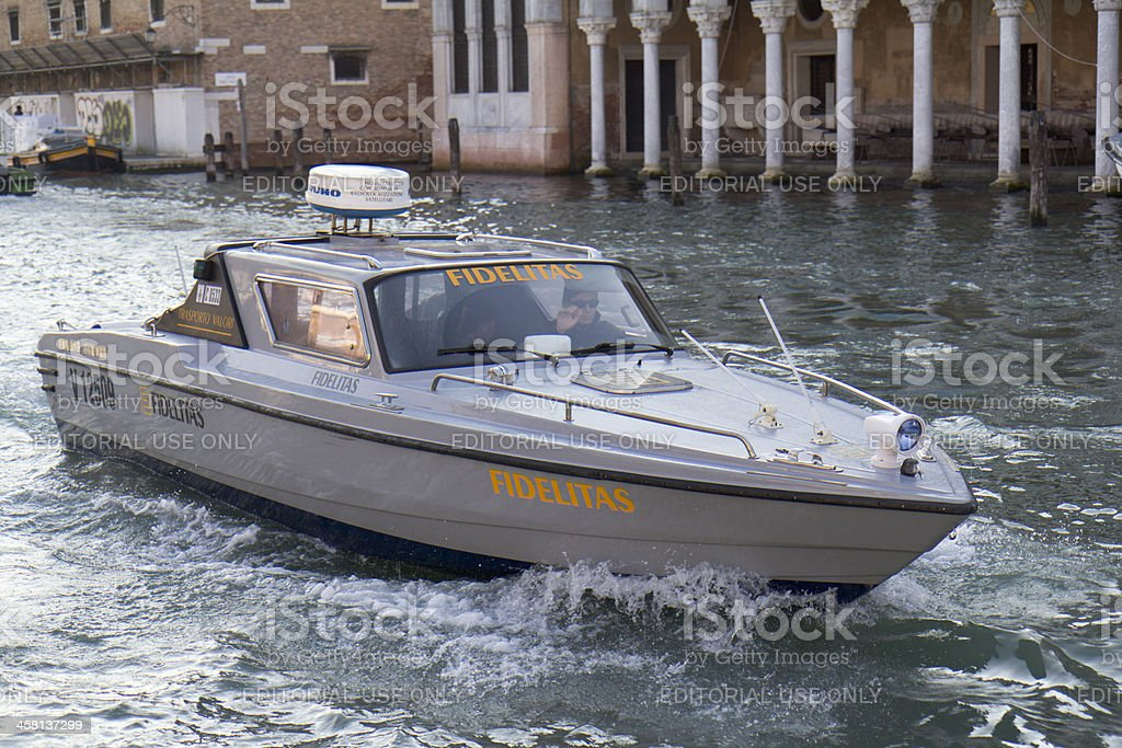 Boat transfering funds on the Grand Canal. royalty-free stock photo