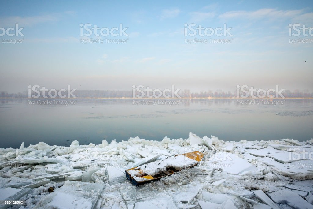 Boat trapped on frozen Danube, Belgrade, Serbia, January 2015 stock photo