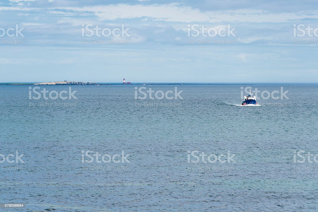 Boat travelling from the Farne Islands in the North Sea stock photo