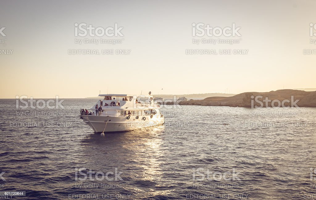 Boat trip during sunset stock photo