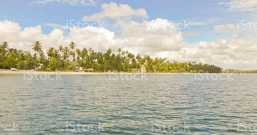 Boat View of the Coast of a Brazilian Beach stock photo
