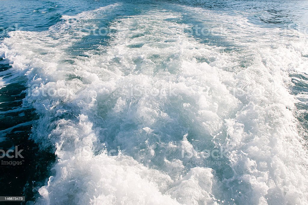 Boat wake from fishing vessel stock photo