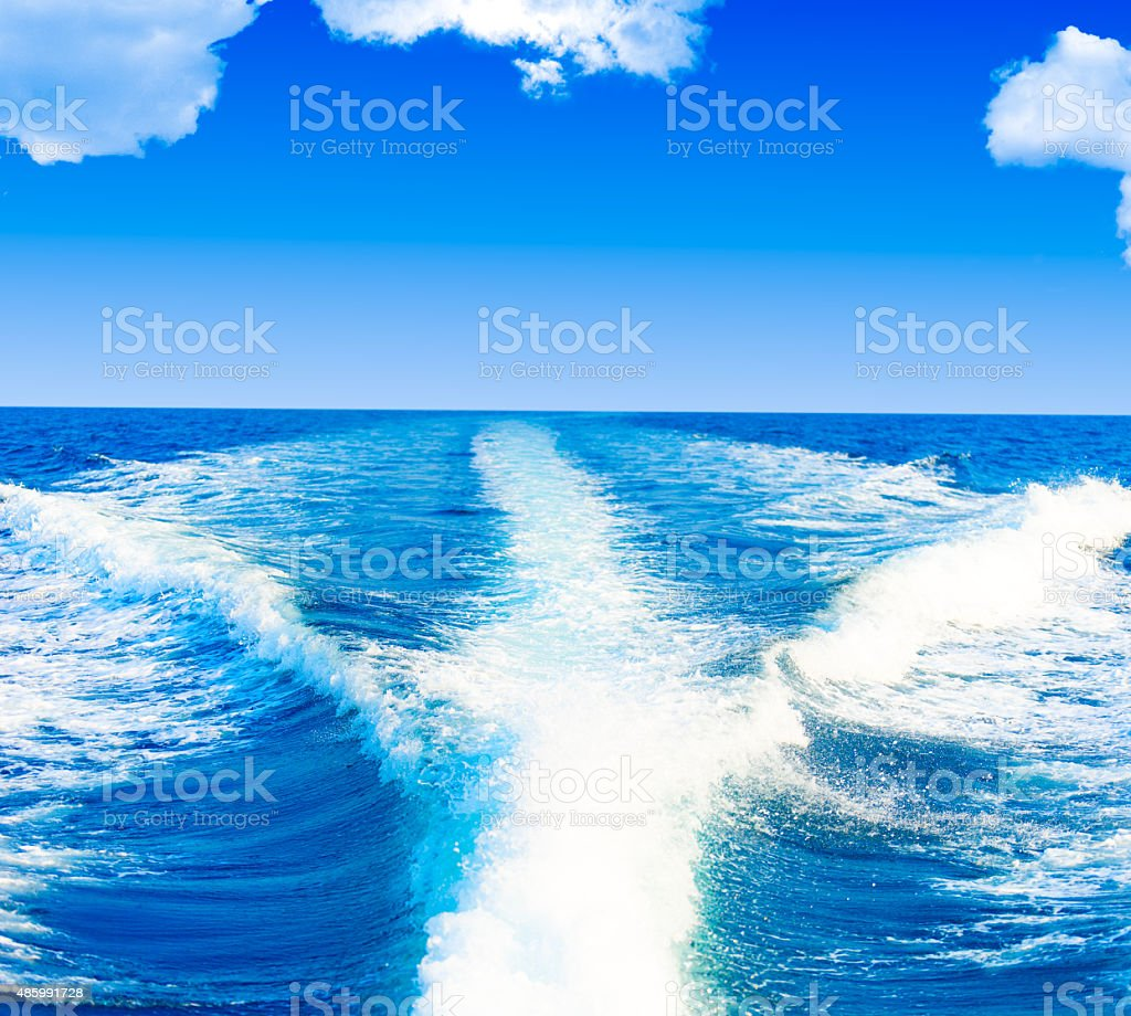 Boat wake prop wash on blue ocean stock photo