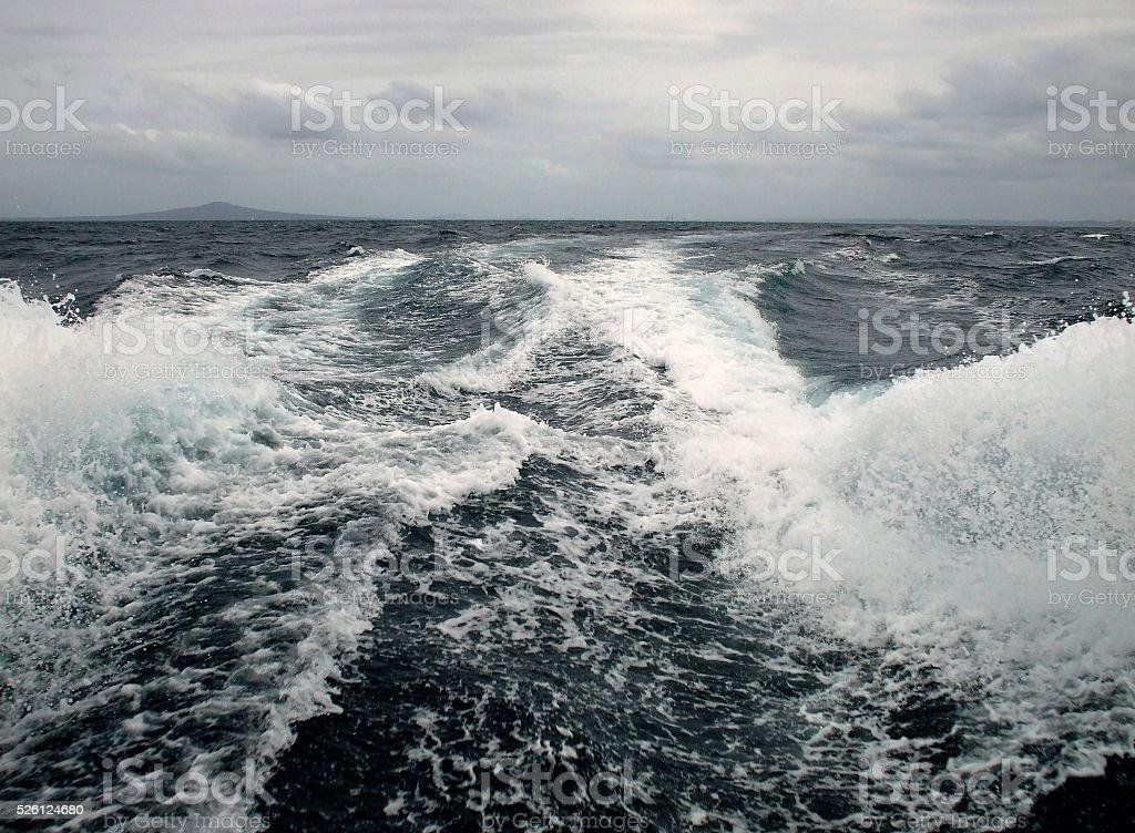 Boat wake with Rangitoto background stock photo