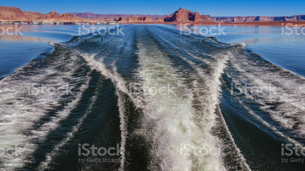 Boat Wake, with Sandstone Geological Formations - Lake Powell stock photo