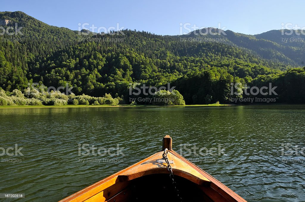Boat, water, wood and sky royalty-free stock photo